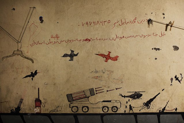 Graffiti left behind by Taliban fighters remains on the walls of a compound now used as a command center for the U.S Marine Corps's First Battalion, Eighth Marines at Musa Qala in southern Afghanistan's Helmand province, November 10, 2010. (Photo by Finbarr O'Reilly/Reuters)