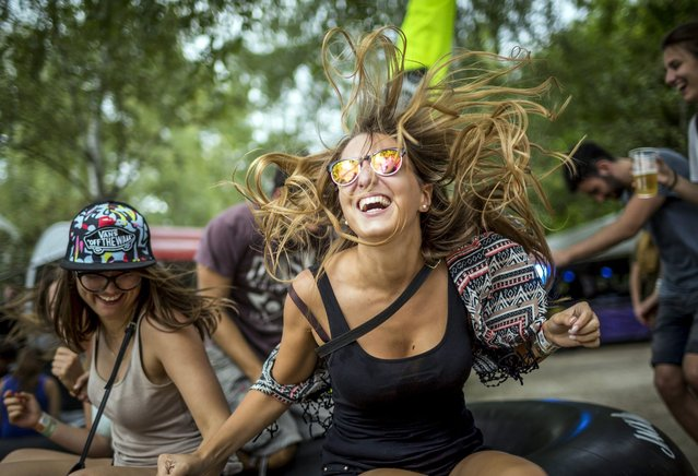 Festival goers laugh at the 24th Sziget Festival, in Budapest, Hungary, 13 August 2016. (Photo by Balazs Mohai/EPA)