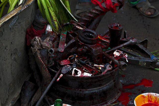 Car keys and other metals, which represent the jobs of worshippers of the iron god Ogun are seen during an annual prayer and sacrifice celebration in Abuja, Nigeria, June 23, 2015. (Photo by Afolabi Sotunde/Reuters)