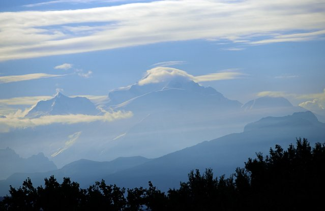 The Mont Blanc massif is pictured after sunrise, from Geneva September 9, 2014. (Photo by Denis Balibouse/Reuters)