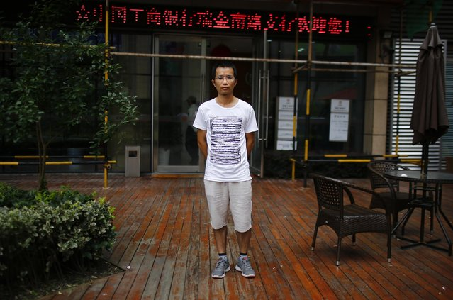 "Qin Wen, who was born in 1983, poses for a photograph in Shanghai August 22, 2014. Wen said: ""I think it's good to have a brother or a sister"". (Photo by Carlos Barria/Reuters)"