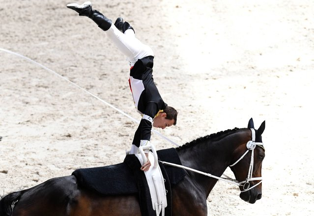 Equestrian vaulting champion, French Vincent Haennel competes on his horse Quartz d'Olbiche, during the men's event of the FEI World Vaulting Championship on August 21, 2016 at the European Horse Pole in Yvre-L'Eveque, northwestern France. (Photo by Jean-Francois Monier/AFP Photo)