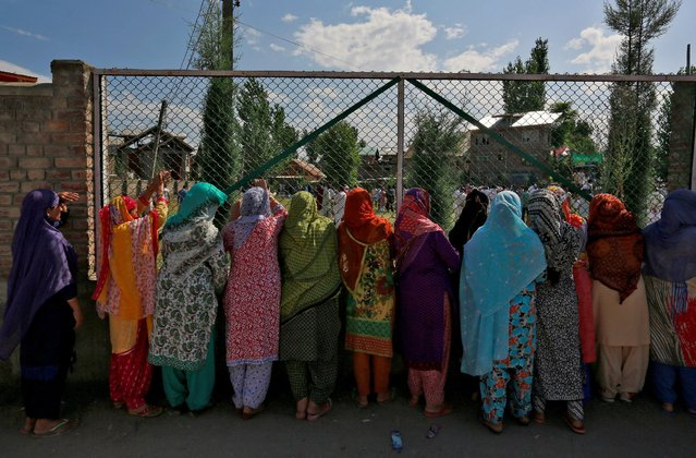 Women in Srinagar watch a demonstration against the recent killings in the region as the city remains under curfew following weeks of violence in Kashmir, August 19, 2016. (Photo by Cathal McNaughton/Reuters)