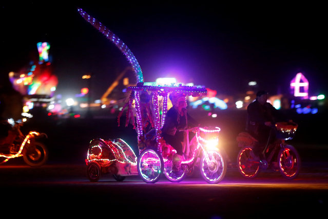 Participants ride on the Playa as approximately 70,000 people from all over the world gather for the 30th annual Burning Man arts and music festival in the Black Rock Desert of Nevada, U.S. September 1, 2016. (Photo by Jim Urquhart/Reuters)