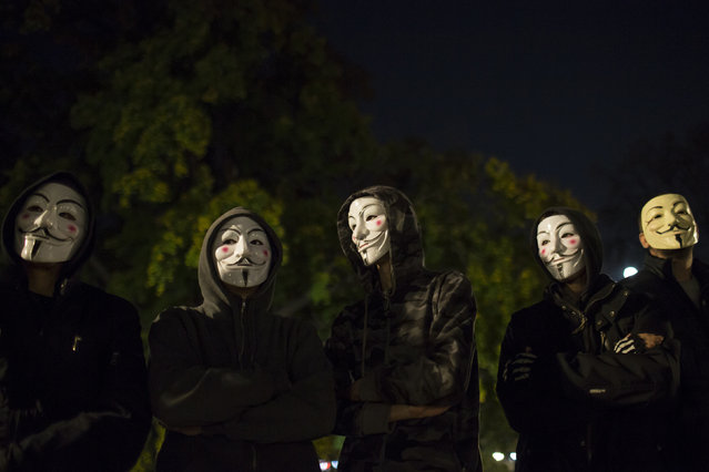 Protesters wearing Guy Fawkes masks stand in a park in downtown Belgrade November 5, 2014. (Photo by Marko Djurica/Reuters)