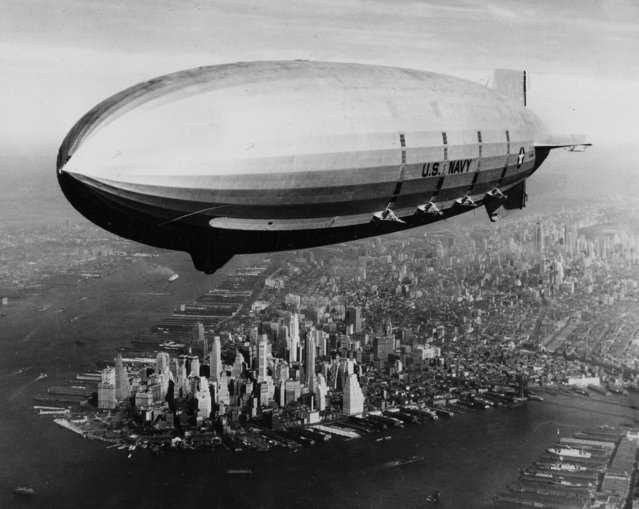 In this photo provided by the U.S. Navy, the USS Macon is shown as it sails over lower Manhattan on October 9, 1933. (Photo by AP Photo/U.S. Navy)