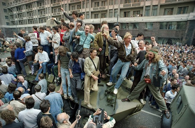 In this August 19, 1991 file photo, crowds of people surround and climb on tanks which were stopped by the crowd as they drove towards the Red Square area of Moscow, Russia, during a military coup after the announced ousting of Mikhail Gorbachev from power. In these critical days when Muscovites turned out to defend the spirit of democracy that Gorbachev had unleashed, and many Soviet officers defied their orders and sided with the people, ensuring that that the plotters failed. (Photo by Boris Yurchenko/AP Photo)