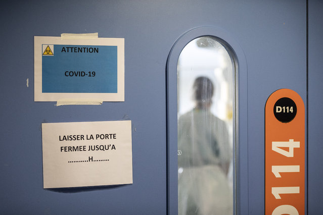 A nurse is seen in a COVID-19 area of the Nouvel Hospital Civil of Strasbourg, Eastern France, Tuesday, September 15, 2020. France is grappling with the double headache of trying revive its COVID-battered economy while also curbing the steady climb in infections spread during summer months when vacationers let their guard down and picked up by increased testing. (Photo by Jean-Francois Badias/AP Photo)