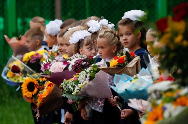 First graders attend a ceremony marking the start of the new school year, as schools reopen after the summer break and the lockdown due to the outbreak of the coronavirus disease (COVID-19), in Moscow, Russia on September 1, 2020. (Photo by Evgenia Novozhenina/Reuters)