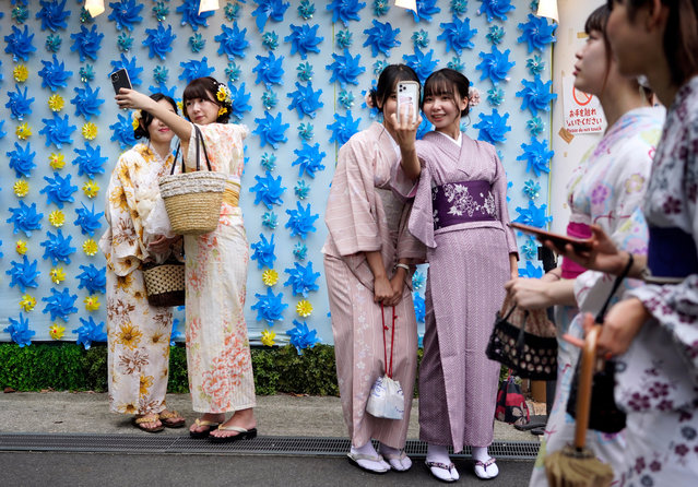 """Japanese women wearing """"yukata"""" casual summer kimono take selfies at Asakusa district in Tokyo, Japan, 13 September 2020. Asakusa is one of Tokyo's most-visited areas and is usually crowded with tourists. In Japan, the numbers of visitors from abroad fell by 99.9 percent from a year earlier in July due to the ban for entries of foreign visitors amid the coronavirus pandemic. (Photo by Franck Robichon/EPA/EFE)"""