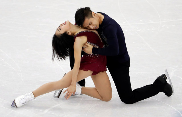 China' s Sui Wenjing and China' s Han Cong compete in the pair skating short program of the figure skating event during the Pyeongchang 2018 Winter Olympic Games at the Gangneung Ice Arena in Gangneung on February 14, 2018. (Photo by Damir Sagolj/Reuters)