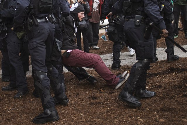 A protester demanding justice for Michael Brown is detained by police in riot gear for disrupting traffic in downtown St. Louis, Missouri November 30, 2014. (Photo by Adrees Latif/Reuters)