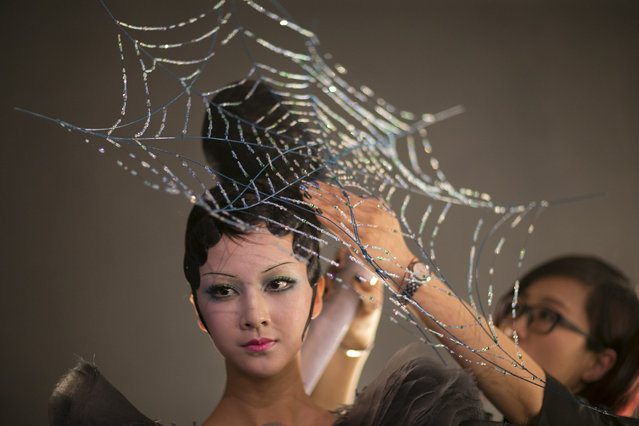 A model prepares backstage before Mao Geping-2016MGPIN Color Make-up Launch Show during the Mercedes-Benz China Fashion Week Spring/Summer 2016 at 751D.PARK Workshop on October 26, 2015 in Beijing, China. (Photo by Lintao Zhang/Getty Images)