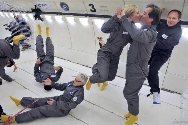Civilian passengers in an Airbus A330 Zero-G jet enjoy moments of weightlessness on March 15, 2013 during the first zero-gravity airplane flight for paying passengers in France. All of the available slots for 2013 and 2014 were sold out, at a cost of 6,000 euros per person. The airplane ride simulates the microgravity of orbital space missions by going through parabolic flight maneuvers that counter the force of gravity. (Photo by Mehdi Fedouach/AFP Photo)