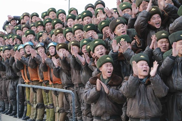 People clap as North Korean leader Kim Jong Un inspects KPA Air and Anti-Air Force Unit 458 honored with the title of O Jung Hup-led 7th Regiment in this undated photo released by North Korea's Korean Central News Agency (KCNA) in Pyongyang December 8, 2014. (Photo by Reuters/KCNA)