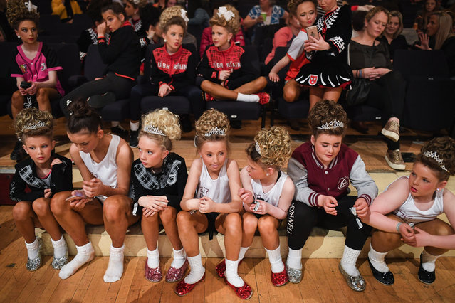 Competitors watch a prize giving ceremony on stage during day three of the World Irish Dancing Championships on March 26, 2018 in Glasgow, Scotland. (Photo by Jeff J. Mitchell/Getty Images)