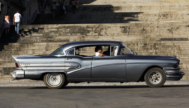 A vintage car drives by Havana's University, June 5, 2009. (Photo by Desmond Boylan/Reuters)