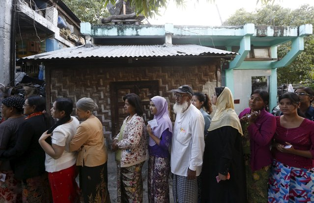 People line up to vote in a mixed Muslim, Buddhist and Hindu neighbourhood during the general election in Mandalay, Myanmar, November 8, 2015. (Photo by Olivia Harris/Reuters)
