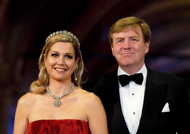 Dutch Crown Prince Willem-Alexander (R) and his wife Crown Princess Maxima arrive at a gala dinner organised on the eve of the abdication of Queen Beatrix of the Netherlands  and the inauguration of her successor King Willem-Alexander at the Rijksmuseum in Amsterdam April 29, 2013. (Photo by Robin Utrecht/Reuters)