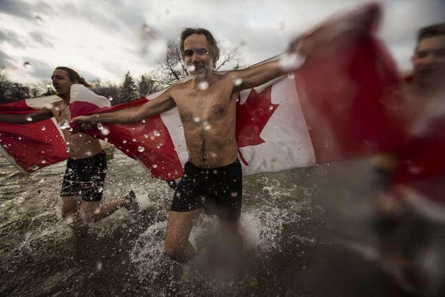 Participants take part in Courage Polar Bear Dip at Coronation Park in Oakville, January 1, 2015. (Photo by Mark Blinch/Reuters)