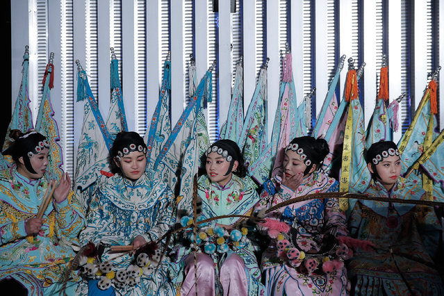 Chinese folk artists dressed in costume drama wait to take part in a New Year's Eve count down to 2015 during a New Year's eve countdown event to promote the city's 2022 Winter Olympic bid at Olympic Park on December 31, 2014 in Beijing, China. (Photo by Lintao Zhang/Getty Images)