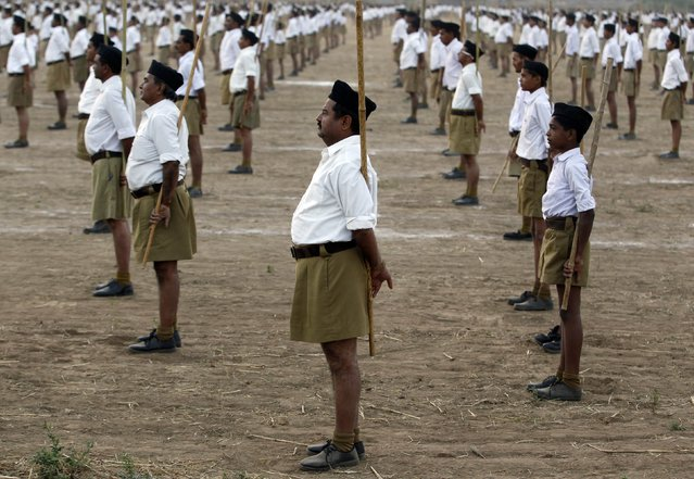 Volunteers of the Hindu nationalist organisation Rashtriya Swayamsevak Sangh (RSS) take part in a drill on the last day of their three-day workers' meeting in the western Indian city of Ahmedabad January 4, 2015. (Photo by Amit Dave/Reuters)