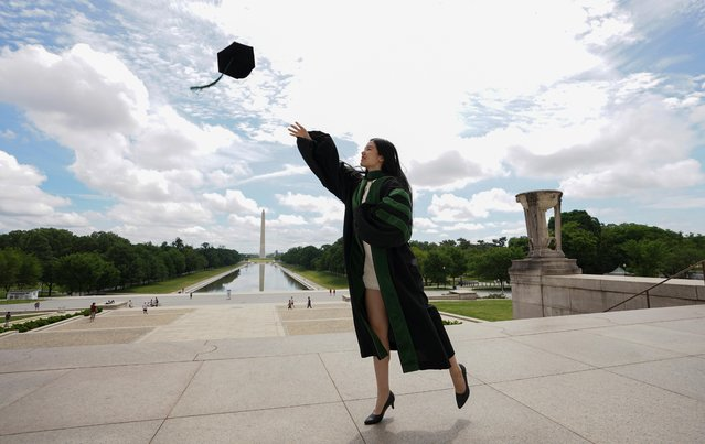 As the national death toll from the coronavirus disease (COVID-19) nears 100,000, Georgetown University medical school graduate He Zhou casts her cap into the air at the Lincoln Memorial in Washington, U.S., May 27, 2020. (Photo by Kevin Lamarque/Reuters)