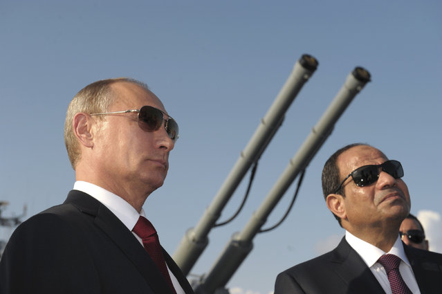 Vladimir Putin and his Egyptian counterpart Abdel Fattah al-Sisi attend a welcoming ceremony on-board guided missile cruiser Moskva at the Black Sea port of Sochi, August 12, 2014. (Photo by Alexei Druzhinin/Reuters/RIA Novosti/Kremlin)