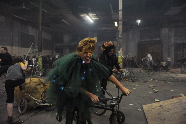 """People ride bicycles in Halloween costumes during """"Bike Kill 13"""" in the Brooklyn borough of New York City, October 29, 2016. """"Bike Kill"""" is an annual gathering of builders and riders of home-made bicycles that culminates in a tall bike jousting competition. (Photo by Stephanie Keith/Reuters)"""