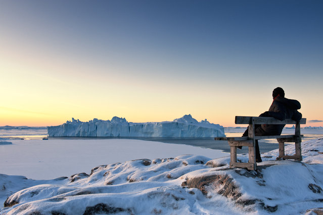 """Arctic dawn"". While gazing at colossal icebergs, I greeted the Artcic Circle mid-winter dawn.(10:17a.m.). Location: Ilulissat, Greenland. (Photo and caption by Takaki Watanabe/National Geographic Traveler Photo Contest)"