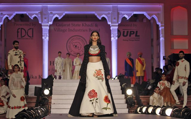 """In this Saturday, January 17, 2015 photo, Bollywood actor Sonam Kapoor displays a creation by designer Rohit Bal during a fashion show to promote """"Khadi"""", or hand-spun fabric in Ahmadabad, India. (Photo by Ajit Solanki/AP Photo)"""