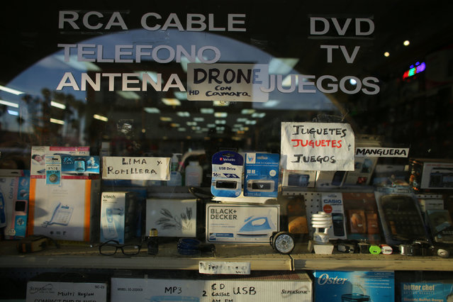 Electronic items are displayed in a shop window in Calexico, California, United States, October 7, 2016. (Photo by Mike Blake/Reuters)