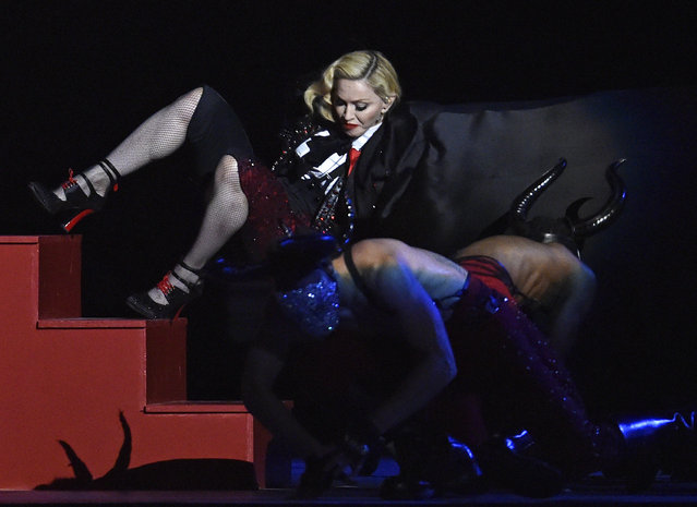 Madonna falls during her performance at the BRIT music awards at the O2 Arena in Greenwich, London, February 25, 2015. (Photo by Toby Melville/Reuters)