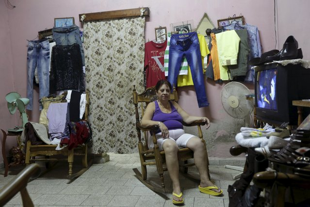 Isabel, 63,  offers clothes for sale in her house in Cmaguey province, Cuba November 12, 2015. Picture taken November 12, 2015. (Photo by Enrique de la Osa/Reuters)
