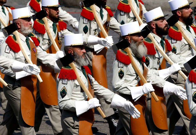 Soldiers from French Foreign Legion take part in the traditional Bastille Day military parade in Paris, July 14, 2013. (Photo by Francois Mori/AP Photo/SIPA)