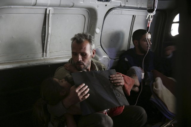 An injured girl is transported in an ambulance after what activists said was shelling by forces loyal to Syria's President Bashar al-Assad, in the Douma neighborhood of Damascus, Syria November 29, 2015. (Photo by Bassam Khabieh/Reuters)