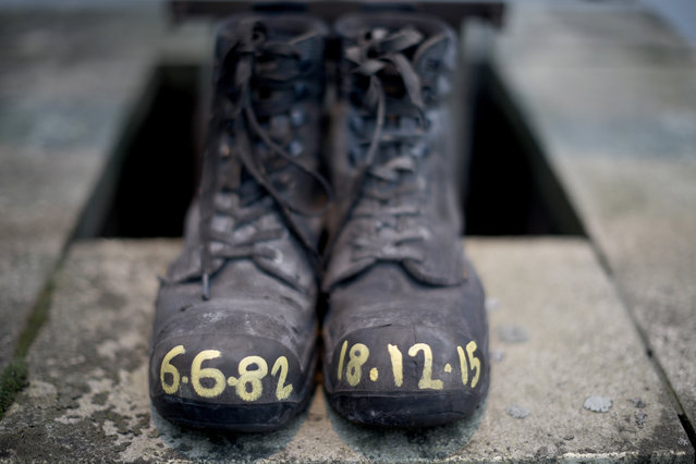 A pair of miners boots are left outside Kellingley Colliery as Miners, union members and the local community take part in a protest march from Knottingley Town Hall to the Miners Welfare Center marking the end of deep coal mining in Britain on December 19, 2015 in Knottingley, England. Kellingley Colliery closed yesterday. The last deep mine in Britain began production in 1965.  Its closure will complete a carefully managed two-year plan for the UKs deep mines. This has been implemented by UK Coal with financial support from the British government. It follows a long period of difficult trading conditions largely due to low international coal prices. (Photo by Christopher Furlong/Getty Images)