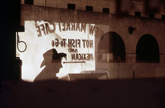 Customer's shadow reflected in window of New Market Cafe in the old Mexican market area of San Antonio, in November of 1972. (Photo by Bob Smith/NARA via The Atlantic)