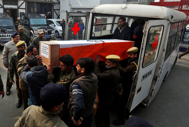 Indian police officers carry a coffin containing the body of their fallen colleague Mohammad Shafi Dar, who according to the police was killed in an encounter with suspected militants on Wednesday, during his wreath ceremony in Srinagar, November 16, 2016. (Photo by Danish Ismail/Reuters)