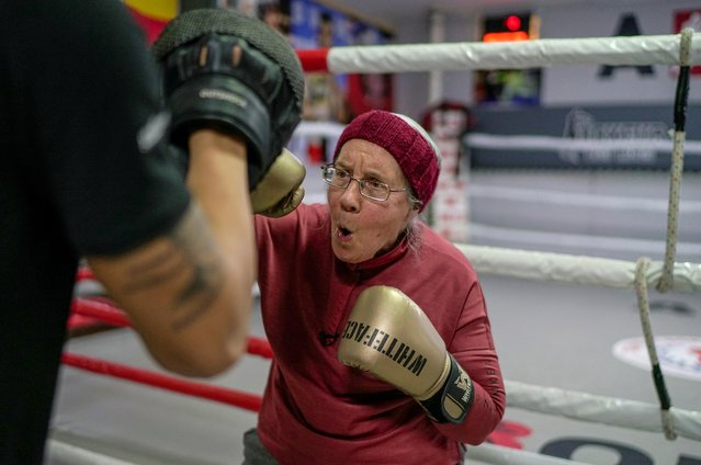 Nancy Van Der Stracten, 75-year-old suffering from Parkinson's disease, practices boxing with her trainer Muhammed Ali Kardas at a boxing club in the southern resort city of Antalya, Turkey, February 26, 2021. (Photo by Umit Bektas/Reuters)