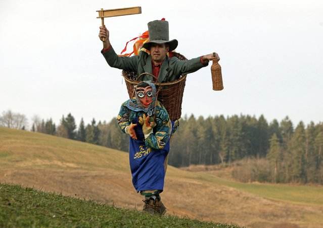 "A man wearing a native costume named ""Woman Carrying Husband"" poses ahead of the Carnival in Sostanj January 15, 2015. (Photo by Srdjan Zivulovic/Reuters)"