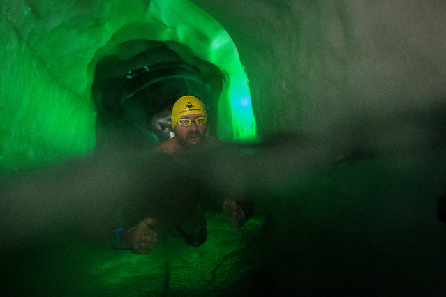 Ice swimmer Josef Koeberl swims in a filled up water kettle in an ice cave inside the Nature Ice Palace, with a hight of 3,250 meters (10,663 feet) above sea level, at Hintertux Glacier near Hintertux, some 480 kilometers (298 miles) western of Vienna, Austria, 28 July 2018. (Photo by Christian Bruna/EPA/EFE)