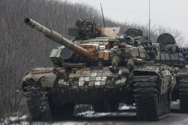 Members of the armed forces of the separatist self-proclaimed Donetsk People's Republic ride on a tank in Vuhlehirsk, Donetsk region February 6, 2015. (Photo by Maxim Shemetov/Reuters)
