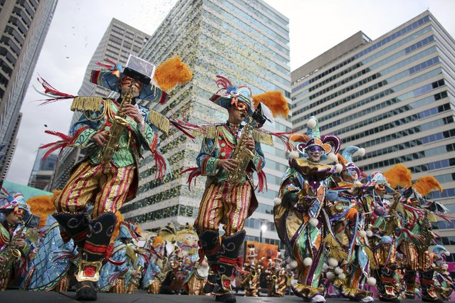 Members of the Aqua String Band perform during the 116th annual Mummers Parade in Philadelphia on Friday, January 1, 2016. (Photo by Joseph Kaczmarek/AP Photo)