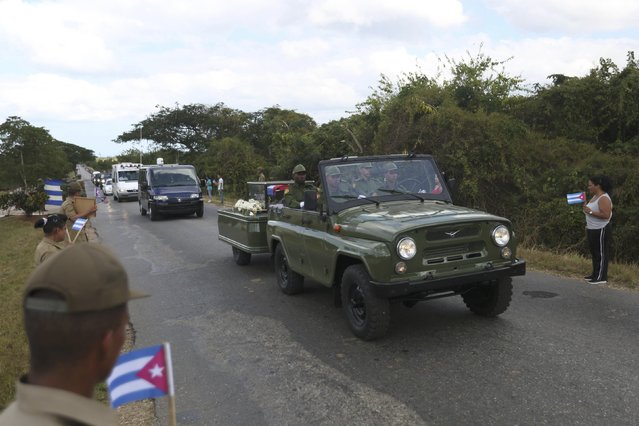 The caravan carrying the ashes of Fidel Castro pass along a highway on the way to the eastern city of Santiago, in Cardenas, Cuba, November 30, 2016. (Photo by Edgard Garrido/Reuters)
