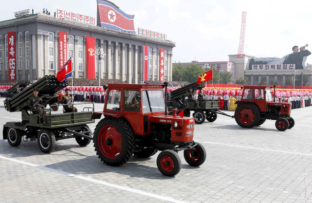 Tractors pull artillery through Kim Il Sung Square during a military parade to mark the 65th anniversary of the country's founding in Pyongyang, North Korea, Monday, September 9, 2013. (Photo by Kim Kwang Hyon/AP Photo)