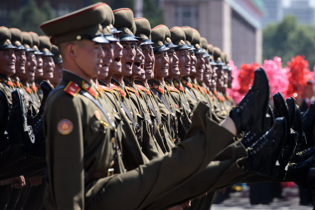 Korean People's Army (KPA) soldiers march during a mass rally on Kim Il Sung square in Pyongyang on September 9, 2018. North Korea held a military parade to mark its 70th birthday, but refrained from showing off the intercontinental ballistic missiles that have seen it hit with multiple international sanctions. (Photo by Ed Jones/AFP Photo)