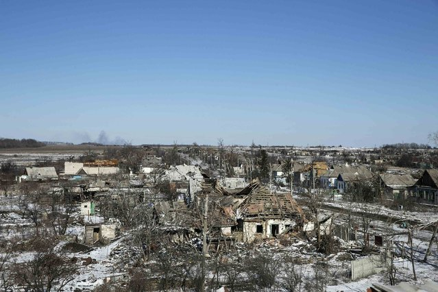 Buildings damaged by fighting are pictured in the village of Nikishine, south east of Debaltseve February 17, 2015. (Photo by Baz Ratner/Reuters)
