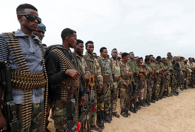 Somali military opposition soldiers from Hawiye clan parade as they move to their barracks after reaching an agreement with the prime minister following clashes over the tenure of the president in Mogadishu, Somalia on May 7, 2021. (Photo by Feisal Omar/Reuters)