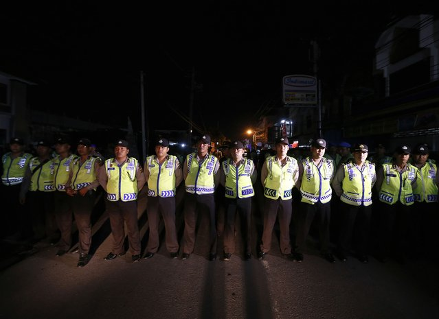 Indonesia policemen stand guard before two Australian death row prisoners, Myuran Sukumaran and Andrew Chan, leave Kerobokan Prison for the airport, in Denpasar, on the Indonesian island of Bali, March 4, 2015. The two convicted Australian drug smugglers were removed from the prison in Bali on Wednesday to be taken to an Indonesian island where they will be shot by firing squad, Australian media reported. The planned executions of Myuran Sukumaran, 33, and Andrew Chan, 31, have ratcheted up diplomatic tensions amid repeated pleas of mercy for the pair from Australia and thrown a spotlight on Indonesia's increasing use of the death penalty for foreigners. REUTERS/Beawiharta